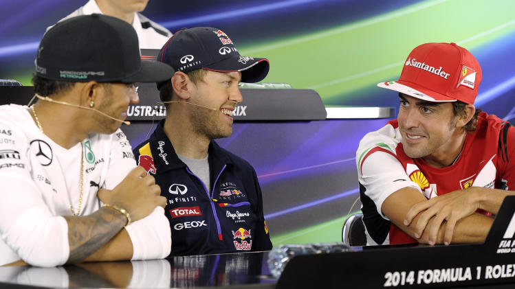 Red Bull driver Sebastian Vettel of Germany center, laughs with Mercedes driver Lewis Hamilton of Britain left, and Ferrari driver Fernando Alonso of Spain during a press conference ahead of the Australian Formula One Grand Prix at Albert Park in Melbourne, Australia, Thursday, March 13, 2014. (AP Photo/Andrew Brownbill)