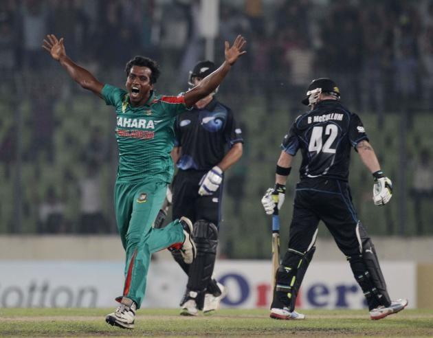 New Zealand's McCullum leaves the field as Bangladesh's Hossain celebrates his dismissal during their first one-day international cricket match in Dhaka