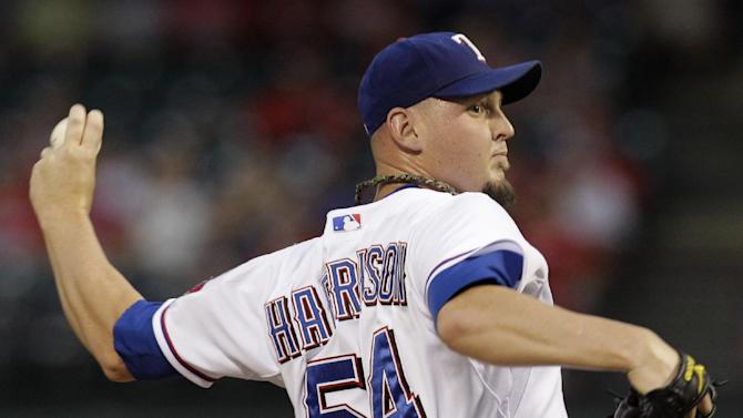 Texas Rangers starting pitcher Matt Harrison delivers to the Cleveland Indians in the first inning of a baseball game Tuesday Sept. 13, 2011, in Arlington, Texas. (AP Photo/Tony Gutierrez)