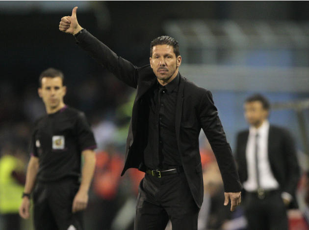 Atletico's coach Diego Pablo Simeone from Argentina gestures during a Spanish La Liga soccer agains Real Club Celta at the Balaidos stadium in Vigo, Spain, Saturday, March 8, 2014