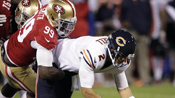 Chicago Bears quarterback Jason Campbell (2) recovers his own fumble after being sacked by San Francisco 49ers linebacker Aldon Smith (99) during the second quarter of an NFL football game in San Francisco, Monday, Nov. 19, 2012. (AP Photo/Tony Avelar)