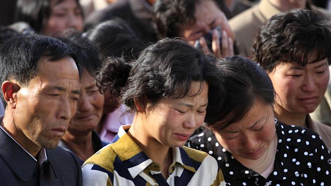 "In this Saturday, May 17, 2014 photo, families of victims of an accident at an apartment construction site in Pyongyang, North Korea grieve during a gathering in the capital where senior officials apologized and took responsibility. The word of the collapse in the secretive nation's capital was reported Sunday morning by the North's official Korean Central News Agency, which gave no death toll but said that the accident was ""serious"" and upset North Korea's leader, Kim Jong Un. (AP Photo/Jon Chol Jin)"