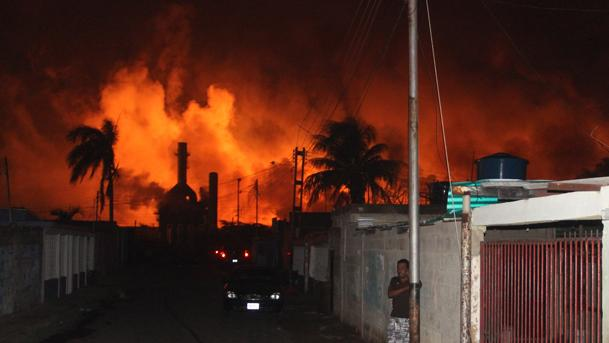 Fire rises over the Amuay oil refinery near Punto Fijo, Venezuela, Saturday, Aug. 25, 2012. A huge explosion rocked Venezuela's biggest oil refinery and unleashed a ferocious fire Saturday, killing over 20 people and injuring dozens in the deadliest disaster in memory for the country's key oil industry. (AP Photo/Diario EL Amanecer)