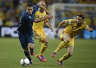 French midfielder Jeremy Menez (L) clashes with Ukrainian midfielder Anatoliy Tymoshchuk during their Euro 2012 championships football match at the Donbass Arena in Donetsk. France leapfrogged Euro 2012 co-hosts Ukraine in the Group D table here on Friday after beating them 2-0