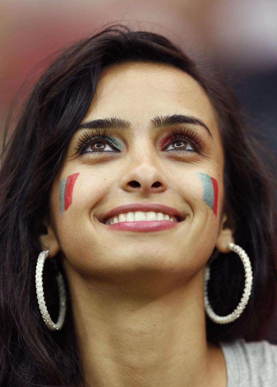 A Czech fan smiles before the Euro 2012 soccer championship quarterfinal match between Czech Republic and Portugal in Warsaw, Poland, Thursday, June 21, 2012. (AP Photo/Jon Super)