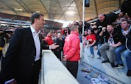 STUTTGART, GERMANY - MARCH 08: Manager Fredi Bobic of Stuttgart discusses with the fans after the Bundesliga match between VfB Stuttgart and Eintracht Braunschweig at Mercedes-Benz Arena on March 8, 2014 in Stuttgart, Germany. (Photo by Alex Grimm/Bongarts/Getty Images)