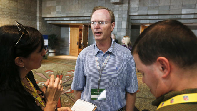 John Mara, co-owner of the New York Giants, speaks with reporters during a break at the NFL football annual meetings, Tuesday, March 19, 2013, in Phoenix. (AP Photo/Ross D. Franklin)
