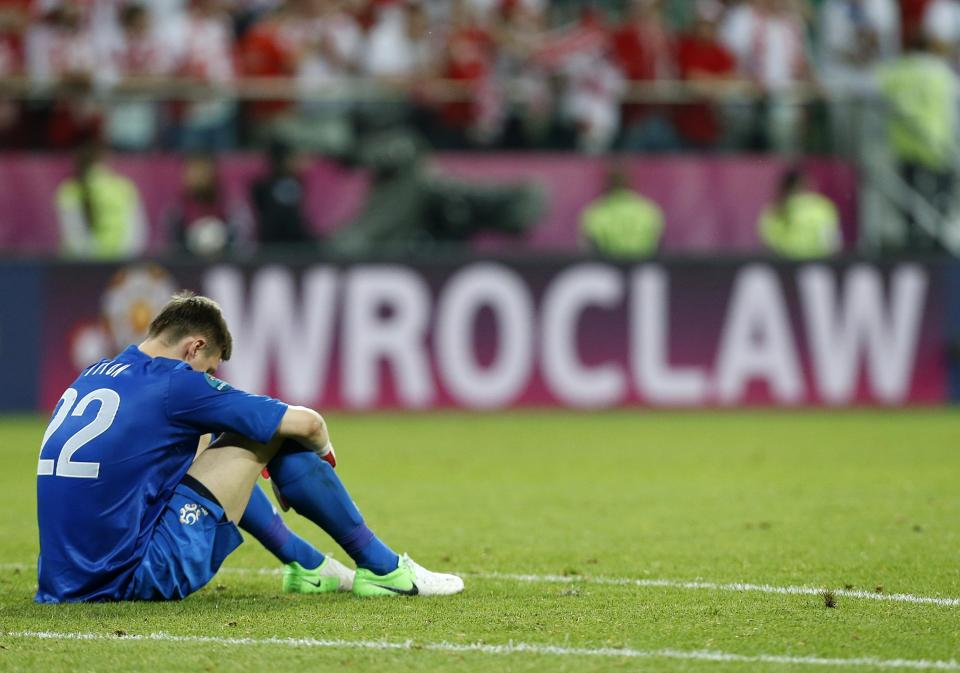 Poland goalkeeper Przemyslaw Tyton sits dejected after the Euro 2012 soccer championship Group A match between Czech Republic and Poland in Wroclaw, Poland, Saturday, June 16, 2012. (AP Photo/Jon Super)