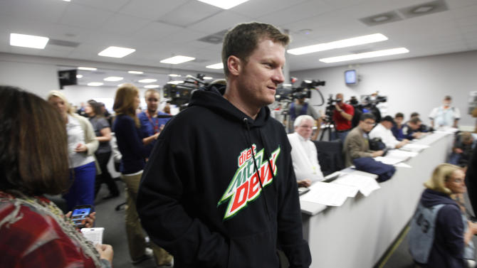 Dale Earnhardt Jr., arrives for a news conference prior to his first practice since recovering from concussions at Martinsville Speedway in Martinsville, Va., Friday, Oct. 26, 2012.  (AP Photo/Steve Helber)