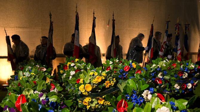 Flag bearers prepare near wreathes prior to dawn service to mark 100th anniversary of ANZAC  Day at Australian National Memorial in Villers-Bretonneux, in northern France