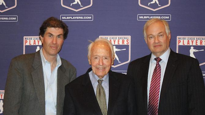 In a photo provided by the Major League Baseball Players Association, Michael Weiner, left, MLBPA executive director; Marvin Miller, center, former head of the association; and Donald Fehr, former MLBPA executive director and currently the executive director of the NHL Players' Association, gather for a photo Tuesday, April 24, 2012, at New York University School of Law in New York, where Miller discussed the 40th anniversary of the first baseball strike. (AP Photo/MLBPA, Ashton Ramsburg)