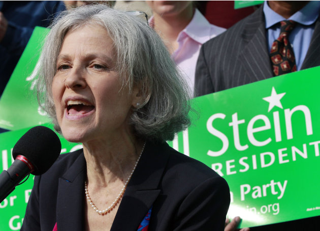 FILE - In this Oct. 24, 2011 file photo, Jill Stein of Lexington, Mass. speaks during a news conference outside the Statehouse in Boston. Stein, a Massachusetts doctor who ran against Mitt Romney for