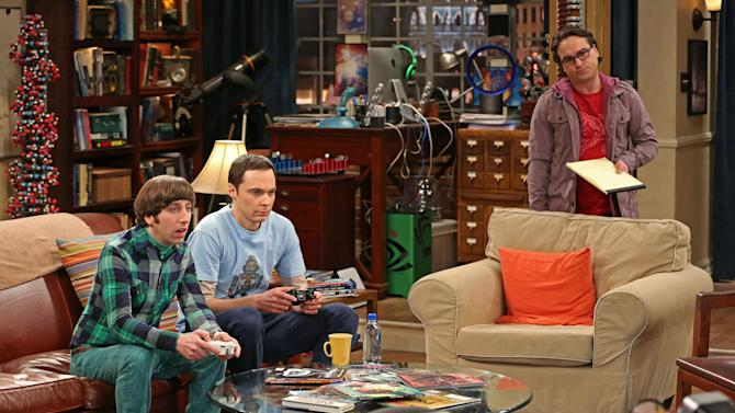 """This undated publicity image released by CBS shows, from left, Simon Helberg, Jim Parsons, and Johnny Galecki in a scene from """"The Big Bang Theory."""" For the 10th time in 11 years, CBS was the nation's most-watched network, the Nielsen company said Thursday, May 23, 2013. TV's top comedy is """"The Big Bang Theory"""" on CBS, averaging 15.6 million viewers per week.  (AP Photo/CBS, Michael Yarish, File)"""