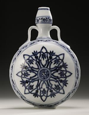 This undated photo provided by Sotheby's shows a rare Ming Dynasty vase that had been used as a doorstop in a Long Island home. The blue and white moonflask was auctioned Wednesday, Sept. 12, 2012 at Sotheby's New York sale of Chinese works of art, fetching $1.3 million. (AP Photo/Sotheby's)