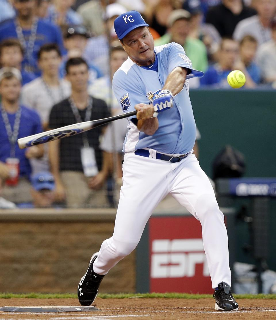 Kansas men's basketball head coach Bill Self hits a home run during the MLB All-Star celebrity softball game, Sunday, July 8, 2012, in Kansas City, Mo. (AP Photo/Charlie Riedel)