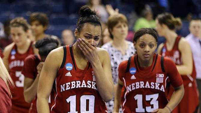 Nebraska forward Meghin Williams (10) becomes emotional as she and guard Brandi Jeffery (13) leave the court after their 53-45 loss to Duke in a regional semifinal in the women's NCAA college basketball tournament, Sunday, March 31, 2013, in Norfolk, Va. (AP Photo/Steve Helber)