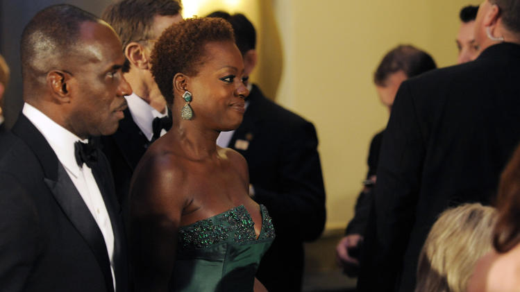 Viola Davis, right, and Julius Tennon at the Governors Ball following the 84th Academy Awards on Sunday, Feb. 26, 2012, in the Hollywood section of Los Angeles. (AP Photo/Chris Pizzello)