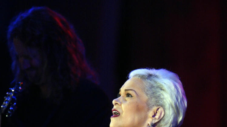 In this Saturday, June 19, 2004, photo, Etta James & The Roots Band perform at the 26th annual Playboy Jazz Festival at the Hollywood Bowl in Los Angeles.    The singer's manager says Etta James has died in Southern California.   Lupe De Leon tells The Associated Press the singer died early Friday, Jan. 20, 2012 at Riverside Community Hospital.  De Leon says the cause of death is complications of leukemia.   (AP Photo/Damian Dovarganes)