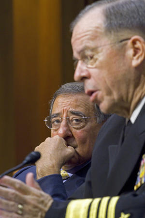 Defense Secretary Leon Panetta looks on at left as Joint Chiefs Chairman Adm. Michael Mullen, testifies on Capitol Hill in Washington, Thursday, Sept. 22, 2011, before the Senate Armed Services Committee hearing on U.S. strategy in Afghanistan and Iraq. (AP Photo/Harry Hamburg)