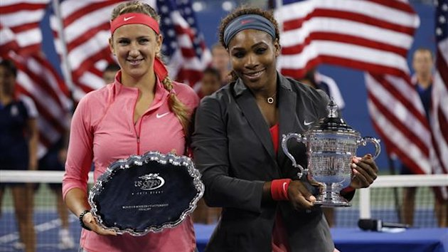 Serena Williams of the U.S. holds her winner's trophy as Victoria Azarenka of Belarus (L) holds the runner up trophy after Williams won their women's singles final match at the U.S. Open (Reuters)