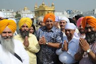 Fiji Prime Minister Voreqe Bainimarama (C) during a trip to Amritsar in April. The International Trade Union Confederation and Human Rights Watch have sent a sharply-worded letter to Bainimarama demanding he repeal &quot;longstanding restrictions on rights&quot;