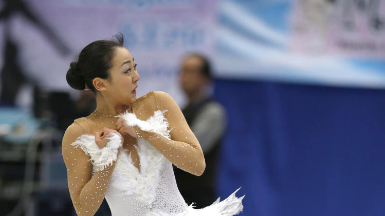 Mao Asada of Japan performs during the women's free skating event at the ISU Four Continents Figure Skating Championships in Osaka, Japan, Sunday, Feb. 10, 2013. (AP Photo/Shizuo Kambayashi)