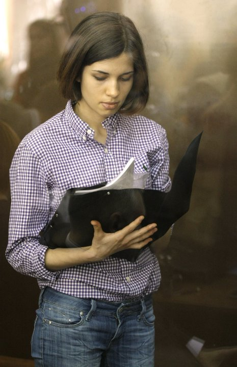 Nadezhda Tolokonnikova, A member of feminist punk group Pussy Riot stands behind a glass wall at a court in Moscow, Russia,  Russia, Monday, July 30, 2012.Three members of the band are facing trial fo