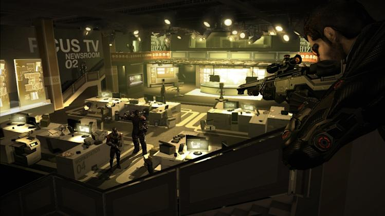 """In this video game image released by Square Enix, Spy Adam Jensen looks for clues in a media company's headquarters in a scene from, """"Deus Ex: Human Revolution."""" (AP Photo/Square Enix)"""