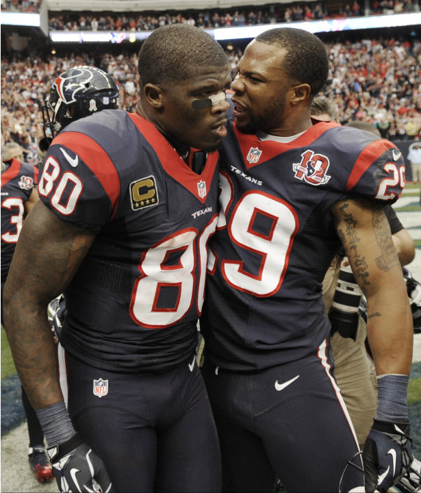 Houston Texans' Andre Johnson (80) and Glover Quin (29) celebrate their 43-37 win over the Jacksonville Jaguars in overtime at an NFL football game on Sunday, Nov. 18, 2012, in Houston. (AP Photo/Dave