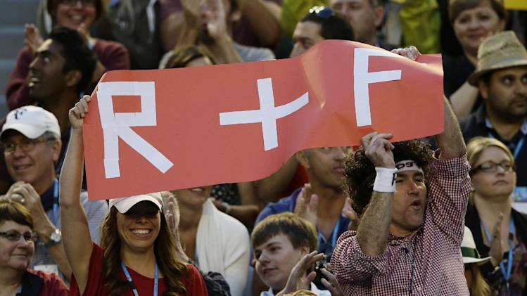 Supporters of Switzerland's Roger Federer wave a banner of support during his third round match against Australia's Bernard Tomic at the Australian Open tennis championship in Melbourne, Australia, Saturday, Jan. 19, 2013. (AP Photo/Andy Wong)