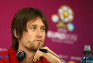 In this handout image provided by UEFA, Tomas Rosicky of Czech Republic talks to the media during a press conference on the eve of the Group A match between Czech Republic and Poland on June 15, in Wroclaw. Rosicky's chances of playing in Thursday's Euro 2012 quarter-final against Portugal are virtually nil according to team manager Vladimir Smicer