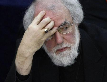 The Archbishop of Canterbury, Rowan Williams listens during the Church of England's General Synod in London February 11, 2009.