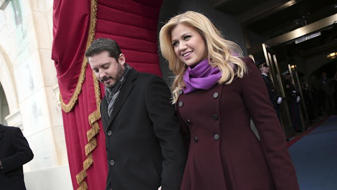 "FILE - In this Monday, Jan. 21, 2013 photo, singer Kelly Clarkson and Brandon Blackstock arrive on the West Front of the Capitol in Washington, for President Barack Obama's ceremonial swearing-in ceremony during the 57th Presidential Inauguration. Clarkson and her music manager Blackstock have gotten married. Clarkson tweeted a photo Monday, Oct. 21, 2013, in her wedding gown next to Blackstock. She wrote: ""I'm officially Mrs. Blackstock."" (AP Photo/Win McNamee, Pool, File)"