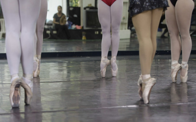 In this photo taken Nov. 25, 2012, Filipino slum dweller Jessa Balote, 3rd from right, points her toes with other students during a class at Ballet Manila at the Philippine capital. Balote, who used t