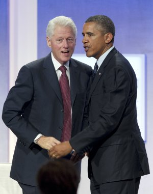 Former President Bill Clinton, left, and President …