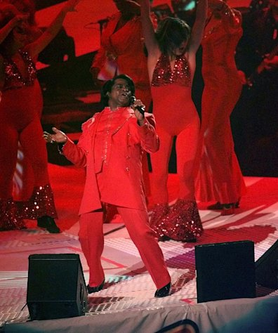 FILE -In this Sunday, Jan. 26, 1997 file photo, James Brown performs during the halftime show at Super Bowl XXXI between the Green Bay Packers and New England Patriots, in New Orleans. The South Carolina Supreme Court on Wednesday, Feb. 27, 2013, overturned a settlement divvying up the multimillion-dollar estate of James Brown, saying a former attorney general didn&#39;t follow the late soul singer&#39;s wishes in putting together the deal. (AP Photo/Mark Duncan, File)