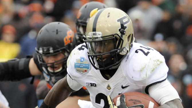 Purdue running back Akeem Shavers (24) looks for running room around Oklahoma State linebacker Ryan Simmons, bottom, during the first half of the Heart of Dallas Bowl NCAA college football game, Tuesday, Jan. 1, 2013, in Dallas. (AP Photo/Matt Strasen)