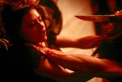 Jody Marken ( Brittany Murphy ) is attacked in USA Films' Cherry Falls