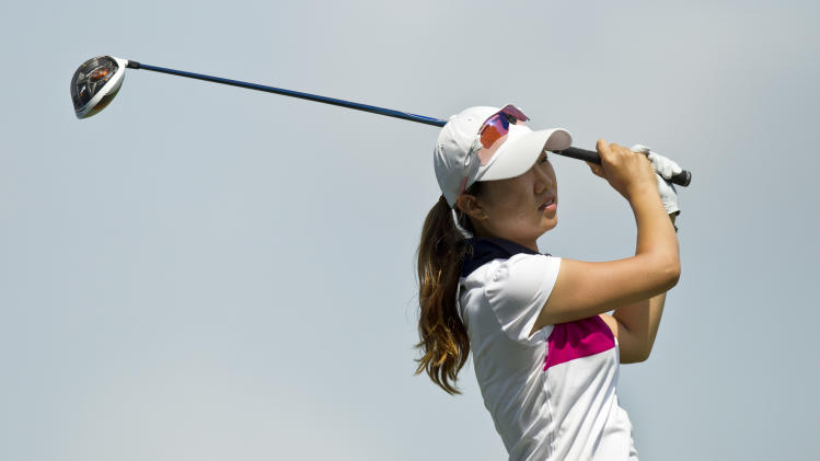 Ji Young Oh, of South Korea, watches her shot from the 16th tee during the second round of the LPGA NW Arkansas Championship golf tournament on Saturday, June 22, 2013, in Rogers, Ark. (AP Photo/Beth Hall)