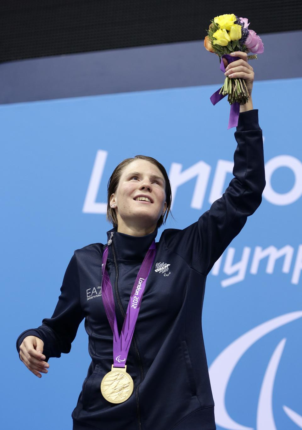 Cecilia Camellini celebrates her gold medal for the women's 50-meter freestyle S11 at the 2012 Paralympics games, Saturday, Sept. 1, 2012, in London. (AP Photo/Alastair Grant)
