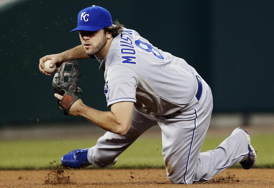 Kansas City Royals third baseman Mike Moustakas stops a ground ball by Detroit Tigers' Andy Dirks in the second inning of a baseball game in Detroit, Monday, Sept. 24, 2012. Dirks was safe at first base. (AP Photo/Paul Sancya)
