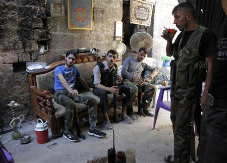 Free Syrian Army fighters rest as they drink tea in the old city of Aleppo