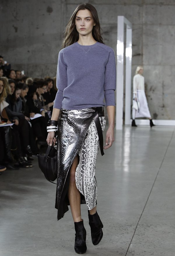 Fashion from the Reed Krakoff Fall 2014 collection is modeled during