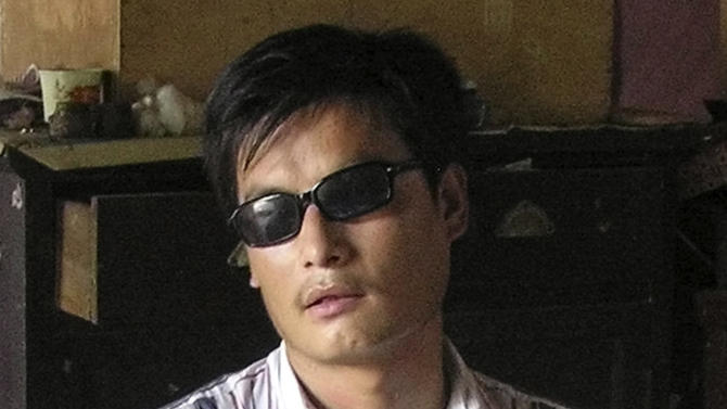 FILE - In this undated file photo provided by supporters of Chen Guangcheng, blind activist Chen Guangcheng sits in a village in China. Assistant Secretary of State Kurt Campbell, who arrived early Sunday, April 29, 2012, in Beijing on a hastily arranged trip as problems from the escape of a blind legal activist to possible new arms sales to Taiwan threaten to derail fragile U.S.-China co-operation. His trip comes after activist Chen Guangcheng escaped from house arrest in his rural village. (AP Photo/Supporters of Chen Guangcheng, File) NO SALES