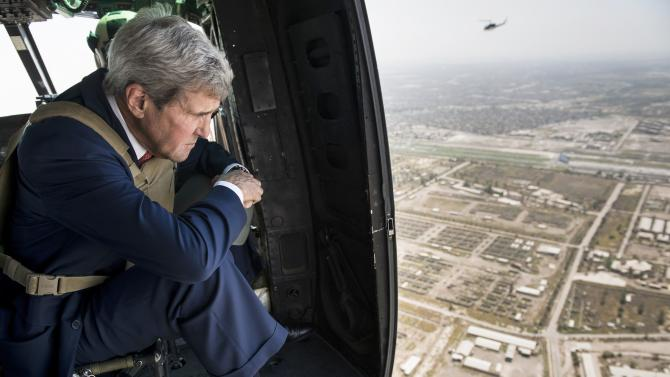 File photo of U.S. Secretary of State Kerry looking out over Baghdad from a helicopter