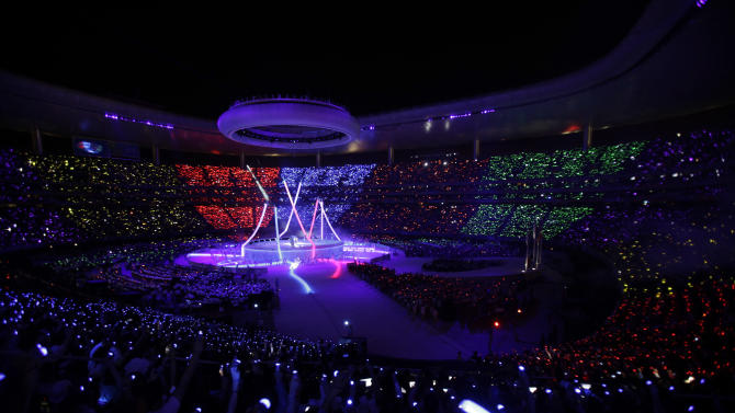 People light up colored torches during the opening ceremonies for the 2011 Pan American Games in Guadalajara, Mexico, Friday, Oct. 14, 2011.(AP Photo/Dario Lopez-Mills)