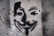 This file photo shows an image on a wall, representing Anonymous Guy Fawkes mask. On Wednesday, the Anonymous forum fired an opening shot by attacking the website of India&#39;s state-run telecom provider MTNL, pasting the logo of the group -- the mask of 17th century revolutionary Fawkes