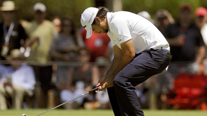 Jason Day, of Australia, reacts after missing a birdie putt on ninth green during the first round of the RBC Heritage golf tournament in Hilton Head Island, S.C., Thursday, April 18, 2013. (AP Photo/Stephen Morton)