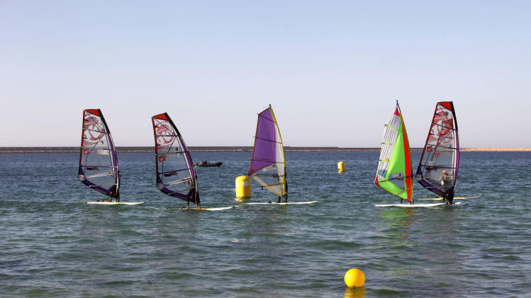 Libyans take part in a local windsurfing competition in the Tripoli