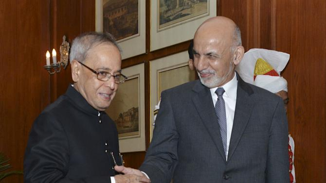 Afghanistan's President Ghani shakes hands with his Indian counterpart Mukherjee before their meeting in New Delhi
